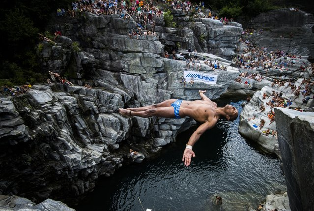 Marcio Lopes from Brazil jumps from a cliff during a cliff diving competition in the Maggia valley in Ponte Brolla, southern Switzerland, Saturday, July 25, 2015. (Photo by Samuel Golay/Keystone/Ti-Press via AP Photo)