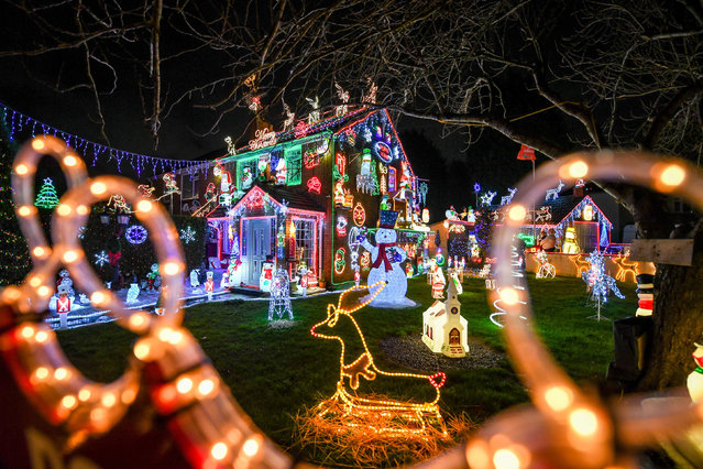 Christmas lights at a house in Brentry, Bristol on December 10, 2019, where the building is decked out with thousands of festive bulbs and displays each year. (Photo by Ben Birchall/PA Images via Getty Images)