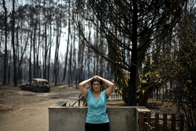 Anabela Silva stands in front of her house with her burnt car in the background after a wildfire in Figueiro dos Vinhos on June 18, 2017. (Photo by Patricia De Melo Moreira/AFP Photo)