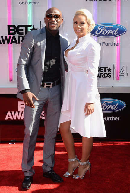 Professional boxer Floyd Mayweather (L) and guest attend the BET AWARDS '14 at Nokia Theatre L.A. LIVE on June 29, 2014 in Los Angeles, California. (Photo by Earl Gibson III/Getty Images for BET)