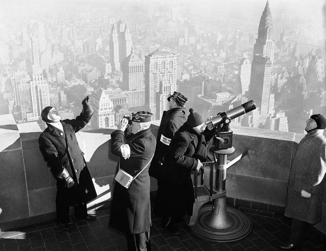 "A crew of observers on the Empire State building, during an air defense test, on January 21, 1941 in New York City, conducted by the U.S. Army. Their job was to spot ""invading enemy"" bombers and send information to centers which order interceptor planes. The tests, to run for four days, covered an 18,000-square-mile area in northeastern states"