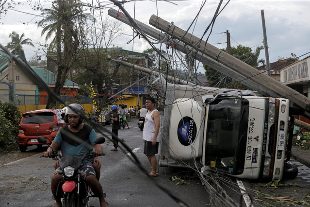 Residents are seen after Typhoon Kammuri hit Camalig town, Philippines, December 3, 2019. (Photo by Nino Luces/Reuters)