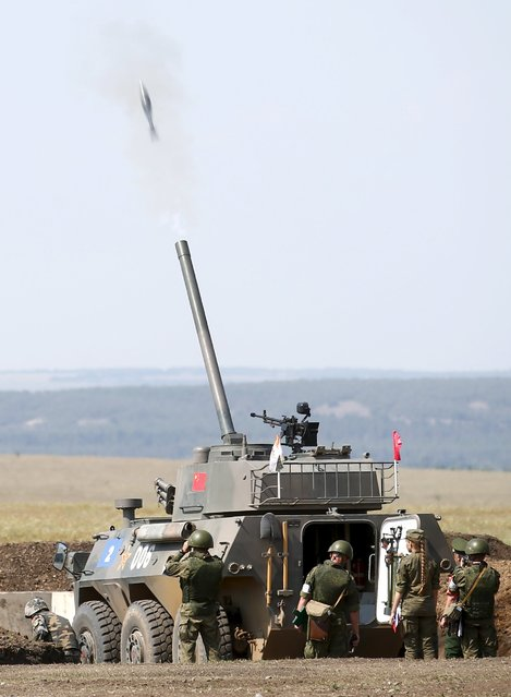 """Chinese servicemen fire a PLL05 (or Type 05) 120 mm self-proppelled mortar-howitzer system during the """"Masters of Artillery Fire"""" competition at a range outside Saratov, Russia, August 10, 2015. The military contest is part of the International Army Games, which are held in Russia from August 1-15, with participants from 17 countries, according to organisers. (Photo by Maxim Zmeyev/Reuters)"""
