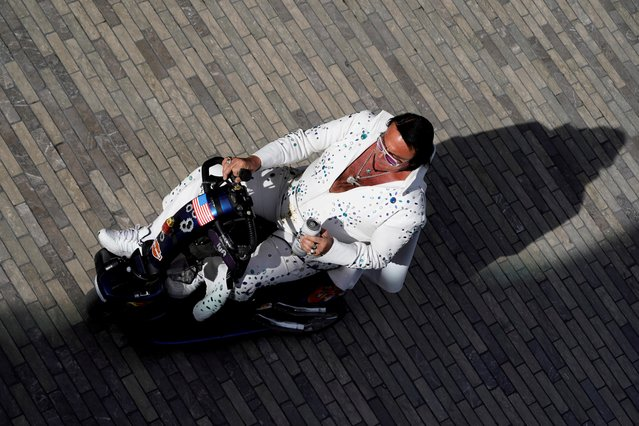 A man dressed as Elvis Presley rides an electric scooter along the sidewalk of the strip in Las Vegas, Nevada, U.S., January 17, 2020. (Photo by Mike Blake/Reuters)