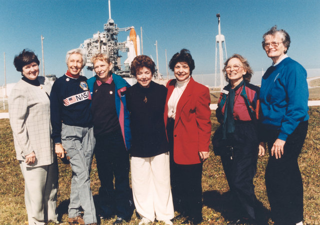 """Exuberant and thrilled to be at the Kennedy Space Center, seven women who once aspired to fly into space stand outside Launch Pad 39B neat the Space Shuttle Discovery, poised for liftoff on the first flight of 1995. They are members of the First Lady Astronaut Trainees (FLATs, also known as the """"Mercury 13""""), a group of women who trained to become astronauts for Americas first human spaceflight program back in the early 1960s. (Photo by NASA)"""