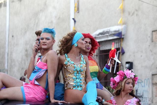 Revellers take part in the annual gay pride parade in Santo Domingo in the Dominican Republic July 3, 2016. (Photo by Ricardo Rojas/Reuters)