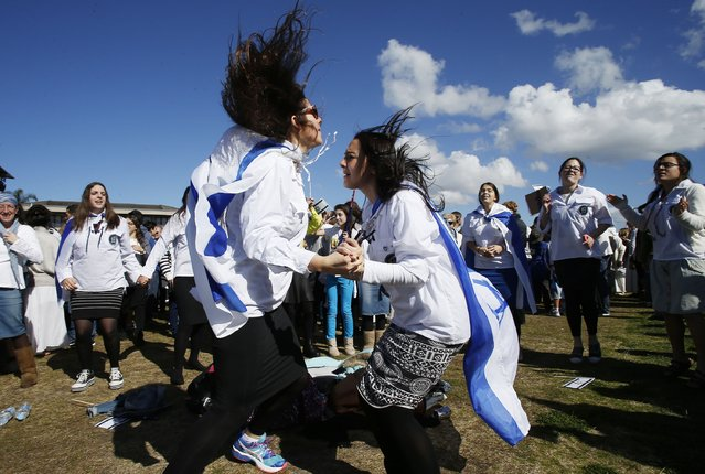 Pro-Israeli activists dance as they gather at Barracluff Park in North Bondi on August 3, 2014 in Sydney, Australia. Pro-Israeli supporters gathered to to condemn Palestinian efforts in Gaza where reportedly 63 Israeli and over 1,650 Palestinians have been killed during the past three weeks of unrest. (Photo by Daniel Munoz/Getty Images)