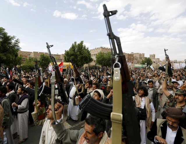 Houthi followers hold up their rifles as they demonstrate against the Saudi-led air strikes in Yemen's capital Sanaa August 24, 2015. (Photo by Khaled Abdullah/Reuters)
