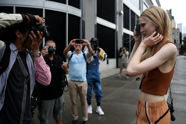 A model takes a photograph of photographers during New York Fashion Week in the Manhattan borough of New York City, U.S., September 13, 2017. (Photo by Amr Alfiky/Reuters)