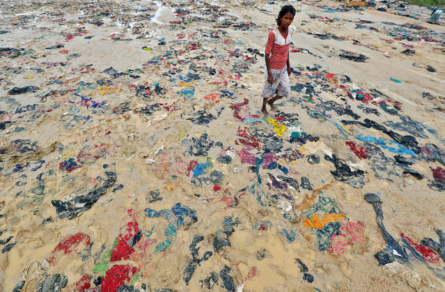 Discarded items of clothing in a Rohingya refugee camp in Cox's Bazar, Bangladesh, September 20, 2017. (Photo by Cathal McNaughton/Reuters)