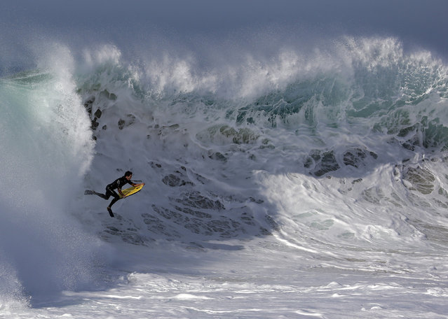 A bogieboarder rides a wave at the wedge in Newport Beach, Calif., Wednesday, August 27, 2014. Southern California beachgoers experienced much higher than normal surf, brought on by Hurricane Marie spinning off the coast of Mexico. (Photo by Chris Carlson/AP Photo)