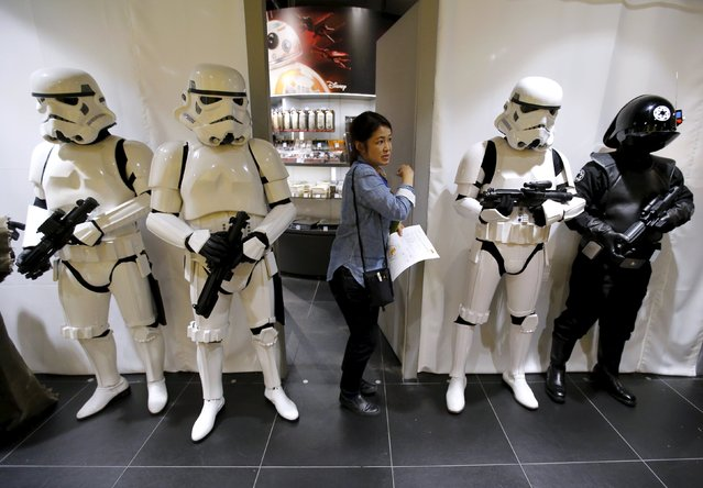 "A store staff walks past other staffs dressed up as Stormtrooper and Death Star Gunner (R) from the film ""Star Wars"" before launching the film's new toys at Loft Variety Store in Shibuya shopping district in Tokyo, September 3, 2015. New ""Star Wars"" toys and other merchandise were released in stores across Japan just after midnight local time during a global rollout of the popular products. (Photo by Toru Hanai/Reuters)"