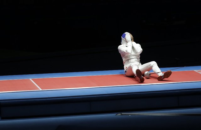 Lauren Rembi, of France, reacts after losing a bronze medal final against Sun Yiwen, of China, in the women's individual epee fencing semifinal event at the 2016 Summer Olympics in Rio de Janeiro, Brazil, Saturday, August 6, 2016. (Photo by Andrew Medichini/AP Photo)