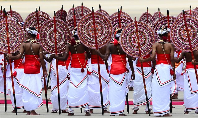"Sri Lankan dancers perform a traditional dance during a welcome ceremony following the arrival of Chinese President Xi Jinping at the Bandaranaike International Airport in Katunayake on September 16, 2014. President Xi Jinping arrived in Sri Lanka September 16 where he will launch construction of a Chinese-backed $1.4 billion port city as he promotes his vision of a ""maritime silk road"" in the face of growing competition from Japan and India. (Photo by Lakruwan Wanniarachchi/AFP Photo)"