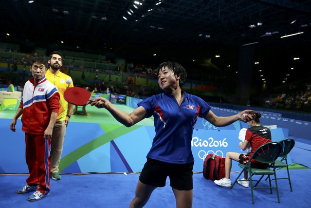 2016 Rio Olympics, Table Tennis, Quarterfinals, Women's Singles, Riocentro, Pavilion 3, Rio de Janeiro, Brazil on August 9, 2016. Kim Song I (PRK) of North Korea celebrates by throwing balls into the audience after winning her match against Yu Mengyu (SIN) of Singapore. (Photo by Alkis Konstantinidis/Reuters)