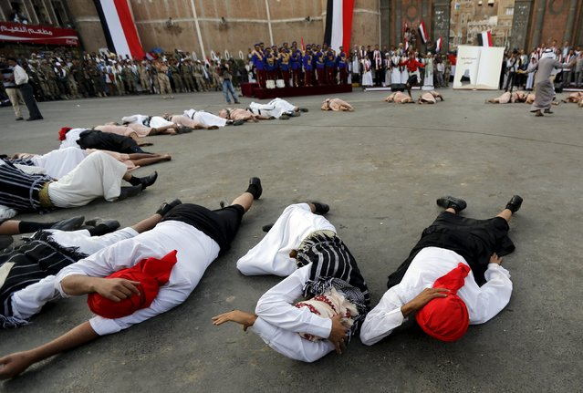 Houthi followers lie on the ground to represent civilian victims of Saudi-led air strikes during a ceremony marking the first anniversary of the Houthi movement's takeover of Yemen's capital Sanaa September 21, 2015. (Photo by Khaled Abdullah/Reuters)