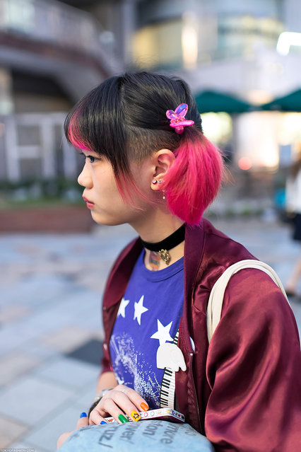 Pink Hair & Butterfly in Harajuku. A friendly Japanese girl with a pink & black hairstyle & pink butterfly hair clips snapped in Harajuku. (Tokyo Fashion)