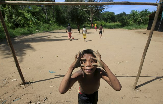 A Colombian Nukak Maku Indian boy gestures in a refugee camp at Agua Bonita near San Jose del Guaviare of Guaviare province September 3, 2015. (Photo by John Vizcaino/Reuters)