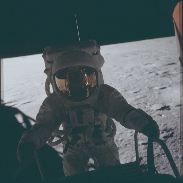 "Astronaut Charles ""Pete"" Conrad Jr., Apollo 12 commander, climbs down on to the lunar surface during the first extravehicular activity of the Apollo 12 mission in this November 16, 1969 NASA handout photo. (Photo by Reuters/NASA)"