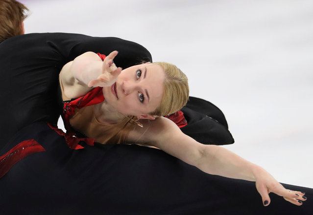 Russia' s Evgenia Tarasova and Russia' s Vladimir Morozov compete in the pair skating short program of the figure skating event during the Pyeongchang 2018 Winter Olympic Games at the Gangneung Ice Arena in Gangneung on February 14, 2018. (Photo by Lucy Nicholson/Reuters)