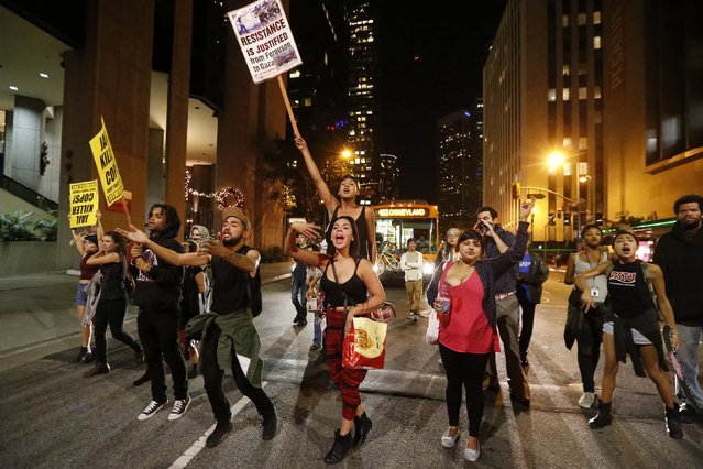 Protesters march in Los Angeles, California, following Monday's grand jury decision in the shooting of Michael Brown in Ferguson, Missouri, November 26, 2014. (Photo by Lucy Nicholson/Reuters)