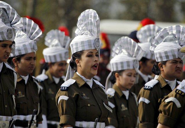 An Indian policewoman yawns as she stands with others during a ceremony to mark Police Commemoration Day in Zewan, on the outskirts of Srinagar, October 21, 2015. Every year on October 21, Police Commemoration Day is observed to remember and pay respects to police personnel across India who were killed in the past year while performing different kinds of duties. (Photo by Danish Ismail/Reuters)