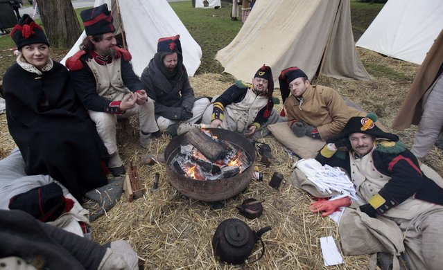 History enthusiasts rest before the re-enactment of Napoleon's famous battle of Austerlitz near the southern Moravian town of Slavkov u Brna November 29, 2014. (Photo by David W. Cerny/Reuters)