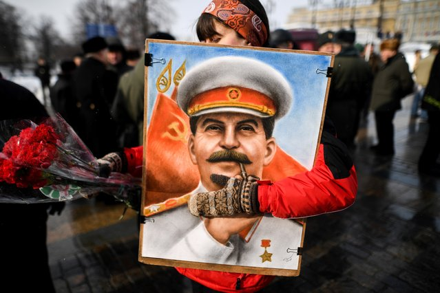 Russian Communist party supporters attend a memorial ceremony to mark the 65th anniversary of Soviet leader Joseph Stalin's death on Red Square in Moscow on March 5, 2018. (Photo by Kirill Kudryavtsev/AFP Photo)