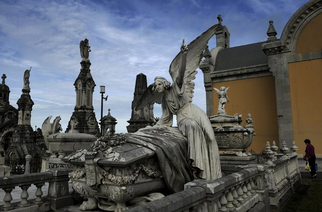 A woman walks next to of the pantheon of the Marquesa de San Juan de Nieva, chosen as the best tomb sculpture of Spain in a Spanish magazine this week, in the municipal cemetery of La Carriona in Aviles, northern Spain, October 29, 2015. (Photo by Eloy Alonso/Reuters)
