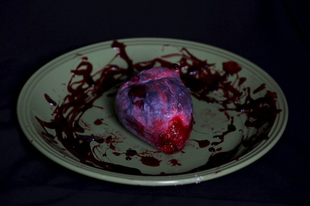 A bloody heart made of gummy candy and red jelly is pictured at the Zombie Gourmet homemade candy manufacturer on the outskirts of Mexico City October 30, 2015. A candy maker in Mexico is raising the stakes this Halloween when it comes to spooky with chewable candy ears and an edible candy foetus for the ultimate prankster. (Photo by Carlos Jasso/Reuters)
