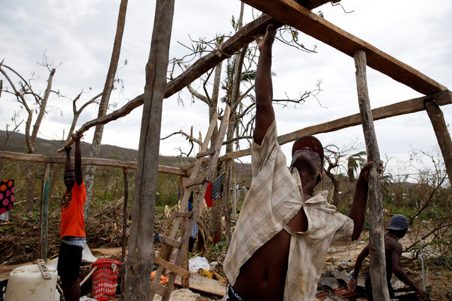 People try to rebuild their destroyed houses after Hurricane Matthew passes Jeremie, Haiti, October 6, 2016. (Photo by Carlos Garcia Rawlins/Reuters)
