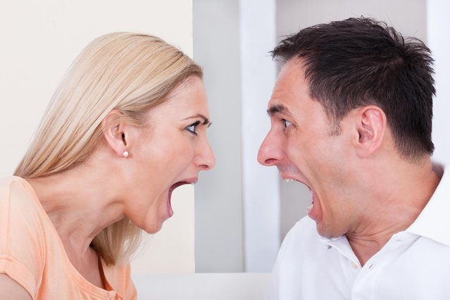 Portrait of angry couple shouting at each other. (Photo by Andrey Popov/Getty Images)