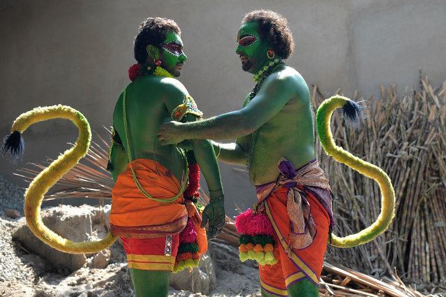 "Indian artists dress up as the Hindu deity ""Hanuman"" – the monkey God in Hindu mythology – to mark the Rama Navami festival in Bangalore on March 25, 2018. Rama Navami is a spring Hindu festival that celebrates the birthday of the deity Rama. He is particularly important to the Vaishnavism tradition of Hinduism, as the seventh avatar of Vishnu. (Photo by Manjunath Kiran/AFP Photo)"