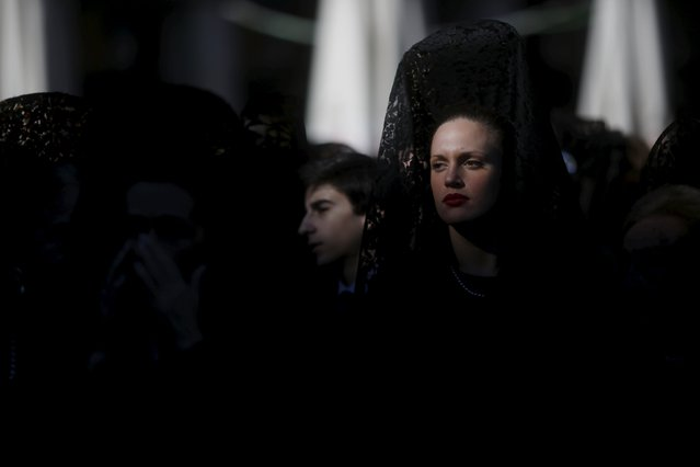 """A woman wearing a traditional """"mantilla"""" dress takes part in an open-air mass to celebrate Madrid's patron saint La Almudena Virgin in Madrid, Spain, November 9, 2015. (Photo by Susana Vera/Reuters)"""
