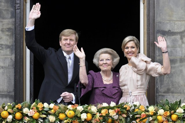 Princess Beatrix of Netherlands (C), her son, Dutch King Willem-Alexander (L) and his wife Queen Maxima wave to the crowd from the balcony of the Royal Palace in Amsterdam April 30, 2013. The Netherlands is celebrating Queen's Day on Tuesday, which will also mark the abdication of Queen Beatrix and the investiture of her eldest son Willem-Alexander. (Photo by Paul Vreeker/Reuters)