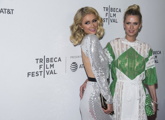 "Paris Hilton, left, and Nicky Hilton Rothschild attend the world premiere of ""The American Meme"" at the 2018 Tribeca Film Festival on Friday, April 27, 2018, in New York. (Photo by Charles Sykes/Invision/AP Photo)"