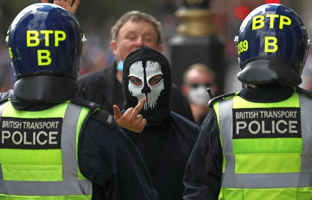 A counter-protester gestures during a Black Lives Matter protest following the death of George Floyd in Minneapolis police custody, in London, Britain, June 13, 2020. (Photo by Simon Dawson/Reuters)