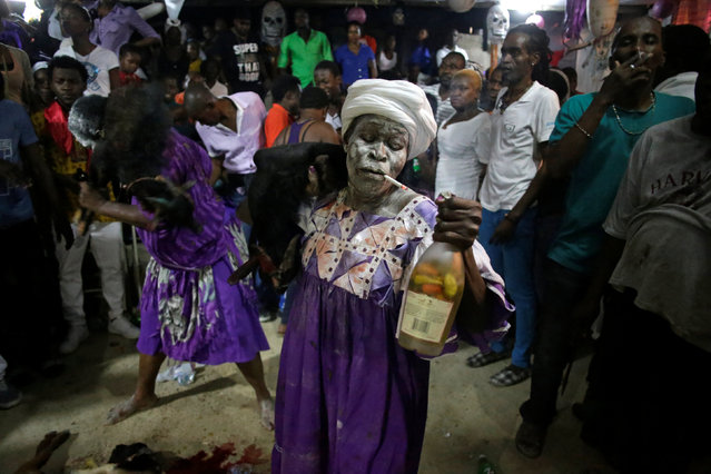 Voodoo believers carry dead goats during a ceremony of Fet Gede in a Peristil, a voodoo temple, in Port-au-Prince, Haiti, November 2, 2016. (Photo by Andres Martinez Casares/Reuters)