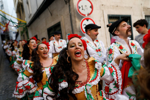 Members of Alfama's group walk down a street on their way to the Saint Anthony's Parade in Lisbon, Portugal June 12, 2018. (Photo by Rafael Marchante/Reuters)