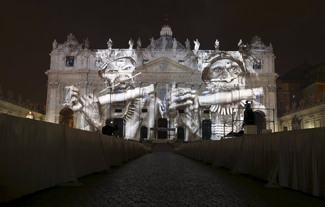 """A picture from Brazilian photographer Sebastiao Salgado, part of an art projection featuring images of humanity and climate change artistically rendered by Obscura Digital, is projected onto the facade of St. Peter's Basilica, as part of an installation entitled """"Fiat Lux: Illuminating our Common Home"""" as a gift to Pope Francis on the opening day of the Extraordinary Jubilee, at the Vatican, December 8, 2015. (Photo by Stefano Rellandini/Reuters)"""