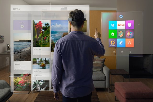 A model wears the Microsoft HoloLens as he scrolls through a virtual Windows menu in this publicity photo released to Reuters January 21, 2015. (Photo by Reuters/Microsoft Corp.)