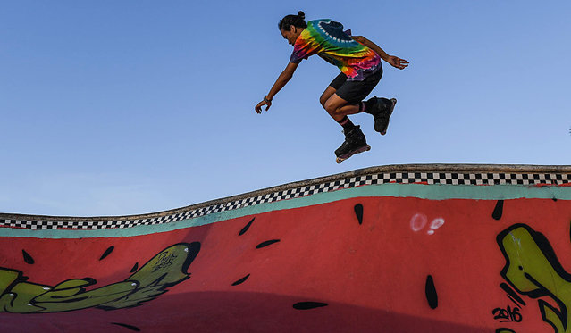A Malaysian youth jumps while inline skating at a park in Shah Alam, outside Kuala Lumpur on October 11, 2016. (Photo by Mohd Rasfan/AFP Photo)