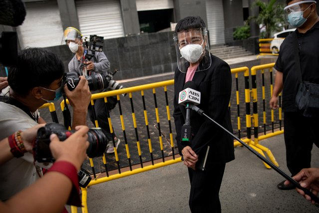 Rappler CEO Maria Ressa walks out of a regional trial court after a scheduled arraignment on her second cyber libel case, in Makati City, Metro Manila, Philippines, December 4, 2020. (Photo by Eloisa Lopez/Reuters)