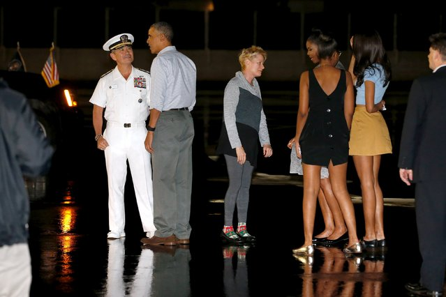 U.S. President Barack Obama (2nd L) and his family are greeted by U.S. Navy Admiral Harry Harris (L) and his wife Bruni Bradley (3rd L) as the Obamas arrive via Air Force One at Joint Base Pearl Harbor-Hickam in Honolulu, Hawaii December 19, 2015. (Photo by Jonathan Ernst/Reuters)