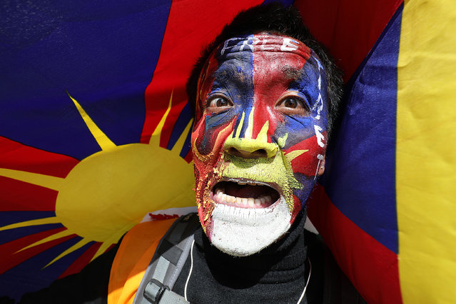 A Tibetan living-in-exile in India attends a peace march during the 62nd Tibetan National Uprising Day in the suburb of McLeod Ganj, the seat of the Central Tibetan Administration in exile, near Dharamsala, India, 10 March 2021. Tibetan Uprising Day is held annually on 10 March and commemorates the Tibetan uprising against the presence of the People's Republic of China in Tibet in 1959. (Photo by Sanjay Baid/EPA/EFE)
