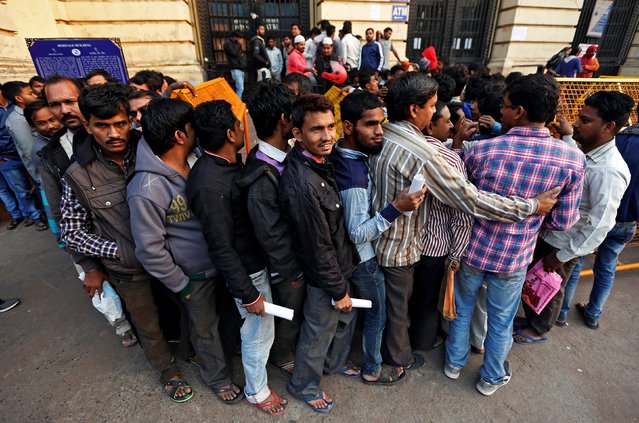 People queue as they wait for the bank to open to exchange their old high-denomination banknotes in the early hours, in the old quarters of Delhi, India, November 16, 2016. (Photo by Adnan Abidi/Reuters)