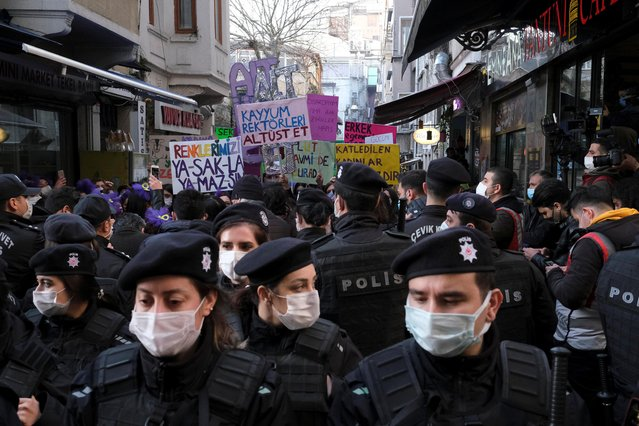 Riot police stand next to demonstrators during an International Women's Day rally in Istanbul, Turkey on March 8, 2021. (Photo by Cansu Alkaya/Reuters)