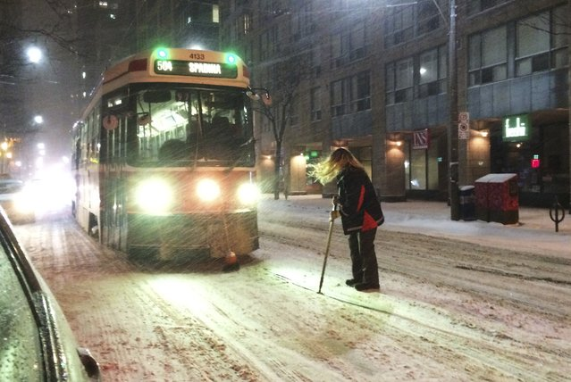 A Toronto Transit Commission (TTC) Streetcar is stopped in its track while the engineer attempts to clears snow on its path during a blizzard condition in Toronto, Ontario February 1, 2015. Southern Ontario is under Winter Storm with blizzard conditions with temperatures hovering at -14 degrees Celsius (6 degrees Fahrenheit). (Photo by Hyungwon Kang/Reuters)