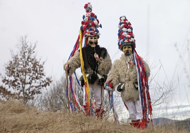 """Members of the Hrusiski Skoromati Ethnological Society dressed as traditional native characters named """"Skoromati"""" pose ahead of the Carnival in Hrusica January 20, 2015. (Photo by Srdjan Zivulovic/Reuters)"""