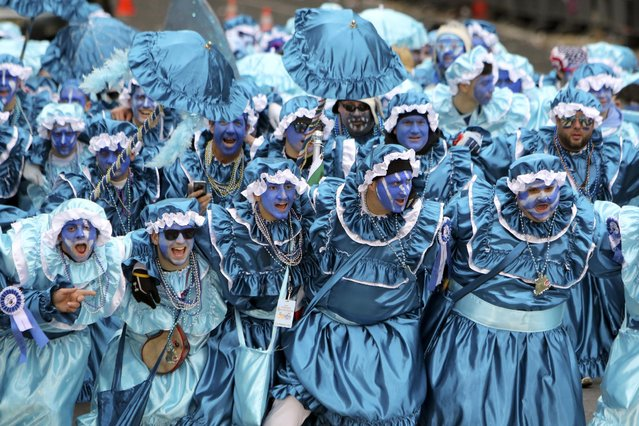 Members of a Comics club perform during the 116th annual Mummers Parade in Philadelphia on Friday, January 1, 2016. (Photo by Joseph Kaczmarek/AP Photo)